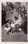 Bessie(Lote)and sons Sonny & Chuck with cousin Namele in the backyard at the house on Alikoho Street.  *Salu>Pesi>Bessie